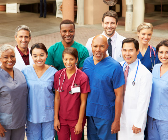 doctors and nurses smiling while standing